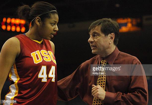 Coach Mark Trakh talks with Nadia Parker during a timeout in 77-73 victory over UCLA in Pacific-10 Conference women's basketball game at Pauley...
