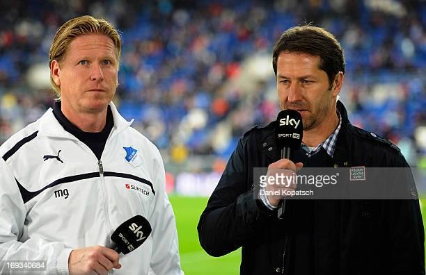 Coach Markus Gisdol of Hoffenheim and Coach Franco Foda of Kaiserslautern talk during an interview prior to the Bundesliga Playoff First Leg match...