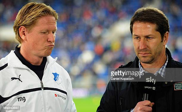 Coach Markus Gisdol of Hoffenheim and Coach Franco Foda of Kaiserslautern talk during an interview prior to the Bundesliga Playoff First Leg match...