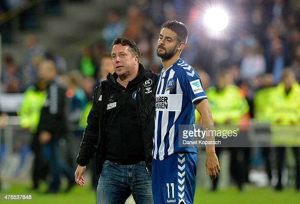 Coach Markus Kauczinski of Karlsruhe and Dimitrij Nazarov of Karlsruhe react during the Bundesliga Playoff second leg match between Karlsruher SC and...