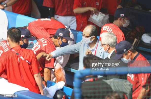 Coach Masaji Shimizu of Team Japan gets a fist bump from Sadaharu Oh in the dugout after Team Japan defeated Team Mexico 7-4 during the baseball...