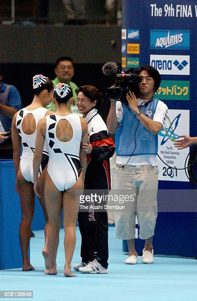 Coach Masayo Imura welcomes Miya Tachibana and Miho Takeda of Japan after the Synchronised Swimming Duet Final at the World Swimming Championships at...