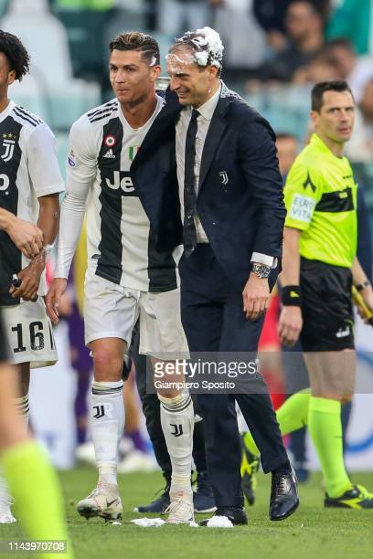 Coach Massimiliano Allegri and Cristiano Ronaldo of Juventus celebrate after winning the Italian league at the end of the Serie A match between...