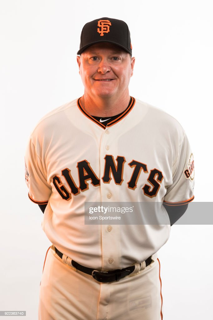Coach Matt Herges (77) poses for a photo during the San Francisco Giants photo day on Tuesday, Feb. 20, 2018 at Scottsdale Stadium in Scottsdale, Ariz.
