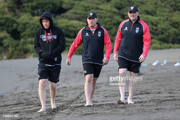 Coach Matthew Elliott Carl Jennings Warriors strength and conditioning coach and sports science manager Brad Morris watche players train on the sand...