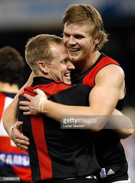 Coach Matthew Knights and Michael Hurley of the Bombers celebrate the Bombers win after the round 17 AFL match between the North Melbourne Kangaroos...