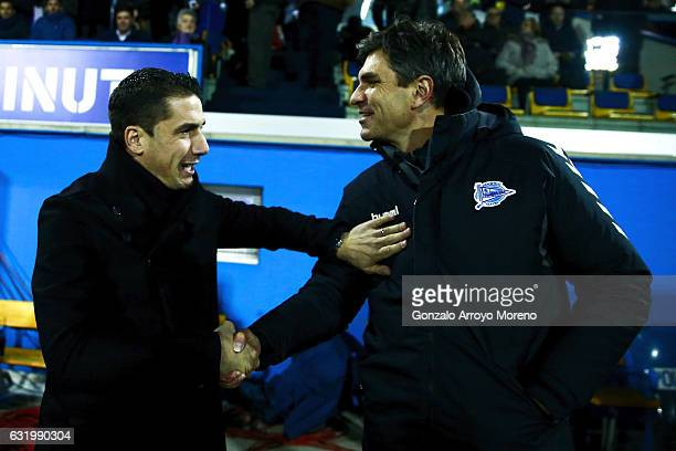 Coach Mauricio Pellegrino of Deportivo Alaves clashes hands with coach Julio Velazquez of Agrupacion Deportivo Alcorcon during the Copa del Rey...