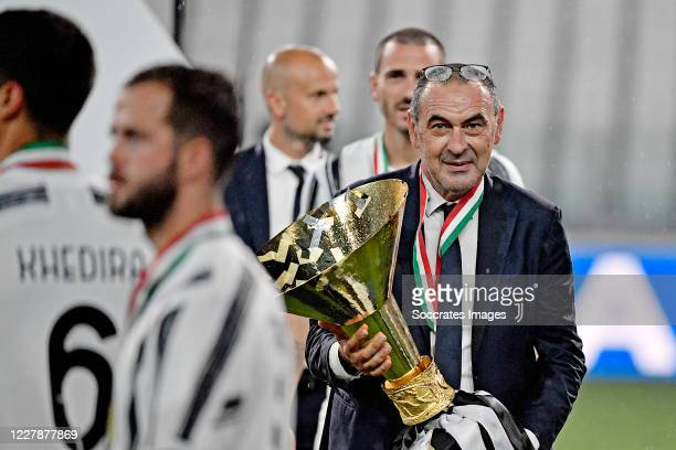 Coach Maurizio Sarri of Juventus celebrates the championship with the trophy during the Italian Serie A match between Juventus v AS Roma at the...