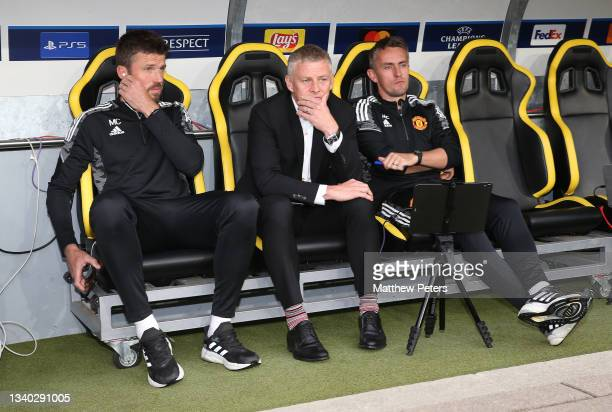 Coach Michael Carrick, Manager Ole Gunnar Solskjaer, Coach Kieran McKenna of Manchester United watch from the bench ahead of the UEFA Champions...