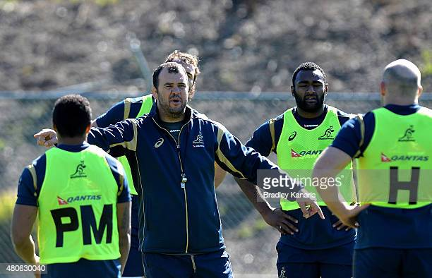 Coach Michael Cheika speaks to his players during an Australian Wallabies training session at Ballymore Stadium on July 14 2015 in Brisbane Australia