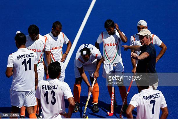 Coach Michael Jack Nobbs of India talks to his team during practice ahead of the 2012 London Olympic Games at the Olympic Park on July 23, 2012 in...