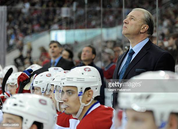 Coach Michel Therrien of the Montreal Canadiens directs his team against the Carolina Hurricanes during their game at PNC Arena on February 8 2014 in...
