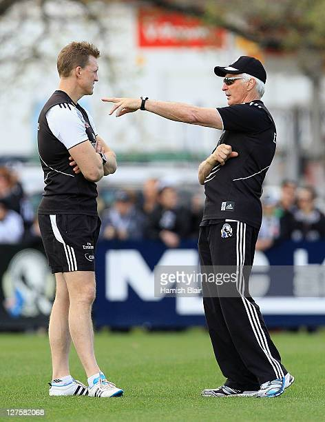 Coach Mick Malthouse and asssistant Nathan Buckley look on during a Collingwood Magpies AFL training session at Gosch's Paddock on September 30 2011...