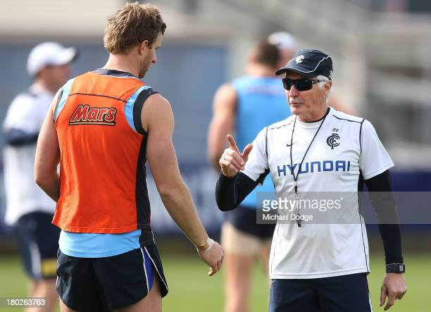 Coach Mick Malthouse gestures to Lachie Henderson during a Carlton Blues AFL training session at Visy Park on September 11 2013 in Melbourne Australia