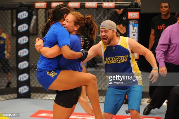 Coach Miesha Tate and Team Tate trainer Brian Caraway celebrate with Julianna Pena after she submits Shayna Baszler in their preliminary fight during...