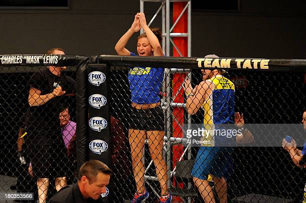 Coach Miesha Tate celebrates after Julianna Pena submits Shayna Baszler in their preliminary fight during filming of season eighteen of The Ultimate...