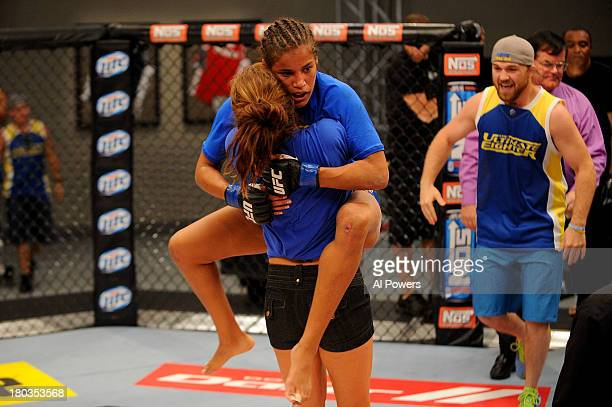 Coach Miesha Tate celebrates with Julianna Pena after she submits Shayna Baszler in their preliminary fight during filming of season eighteen of The...