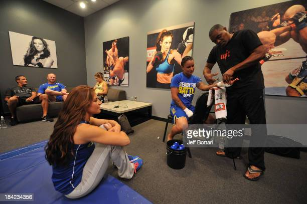 Coach Miesha Tate speaks with Raquel Pennington as she gets her hands wrapped before her matchup against Jessamyn Duke in their preliminary fight...