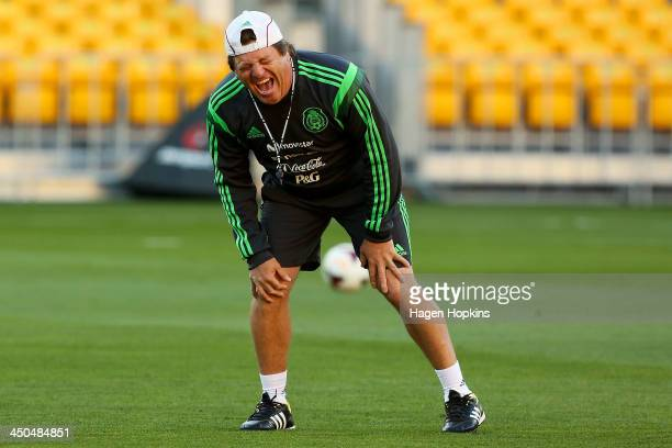 Coach Miguel Herrera of Mexico enjoys a laugh during a Mexico training session and press conference at Westpac Stadium on November 19 2013 in...