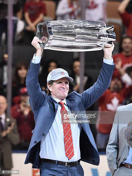 Coach Mike Babcock celebrates with the trophy after Game Two of the World Cup of Hockey 2016 final series at the Air Canada Centre on September 29...