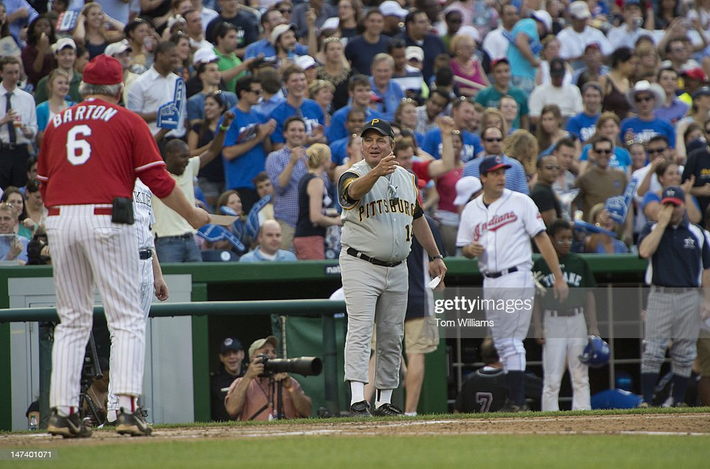 Coach Mike Doyle, D-Pa., center, and Coach Joe Barton, R-Texas, talk about a call at home plate during the 51st Annual CQ Roll Call Congressional Baseball Game held at Nationals Park. The Democrats prevailed over the Republicans 18-5.