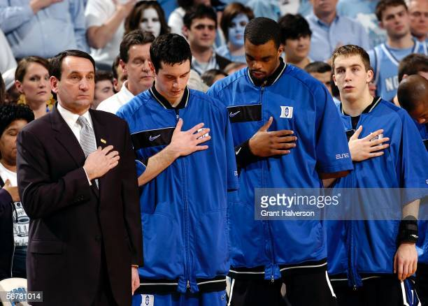 Coach Mike Krzyzewski JJ Redick Shelden Williams and Greg Paulus of the Duke Blue Devils stand for the national anthem before a game against the...