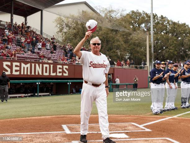 Coach Mike Martin of the Florida State Seminoles wave to the fans before the game against the Maine Black Bears at Dick Howser Stadium on the campus...