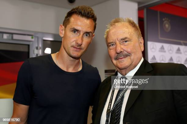 Coach Miroslav Klsoe of Germany and Wolfgang Toibien pose during the Club Of Former National Players Meeting at BayArena on June 8 2018 in Leverkusen...