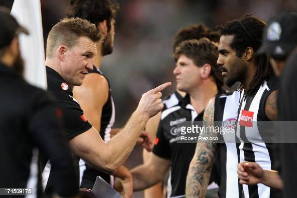 Coach Nathan Buckley of the Magpies speaks with Harry O'Brien of the Magpies during the round 18 AFL match between the Collingwood Magpies and the...