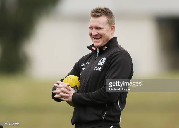 Coach Nathan Buckley reacts during a Collingwood Magpies AFL training session at Olympic Park on September 6 2013 in Melbourne Australia