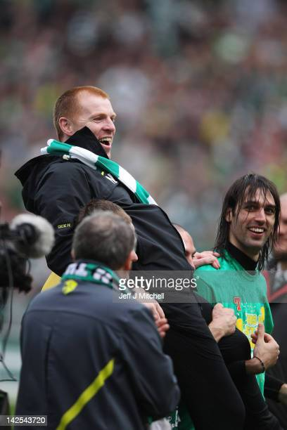 Coach Neil Lennon of Celtic is lifted following his team clinching the Scottish Clydesdale Bank Scottish Premier League title after the match between...