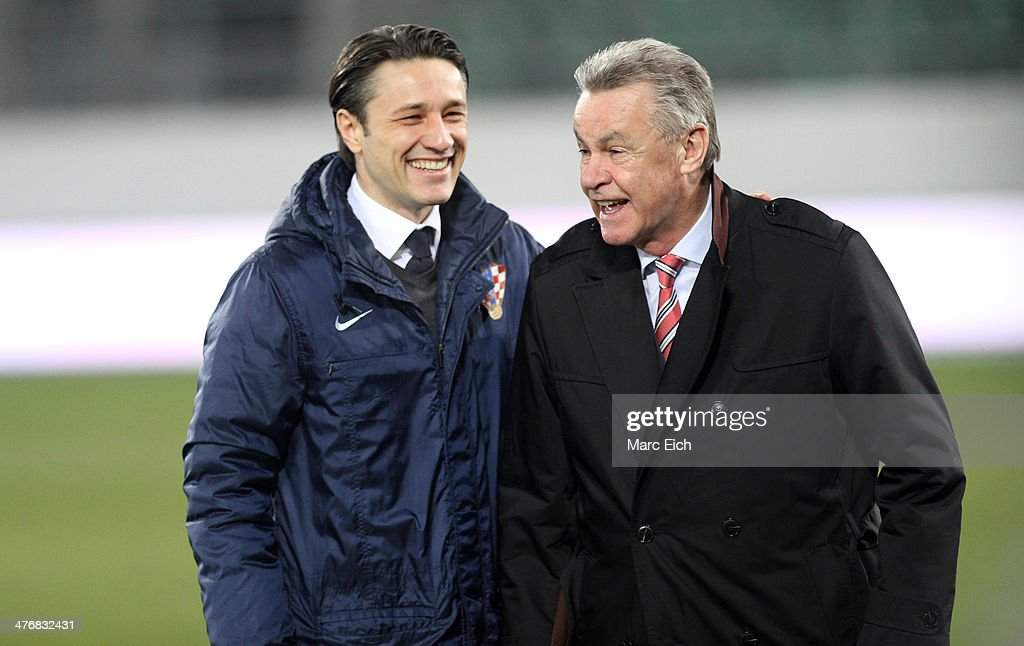 Coach Niko Kovac of Croatia (L) and coach Ottmar Hitzfeld of Switzerland (R) smile prior the international friendly match between Switzerland and Croatia at the AFG Arena on March 5, 2014 in St Gallen, Switzerland.