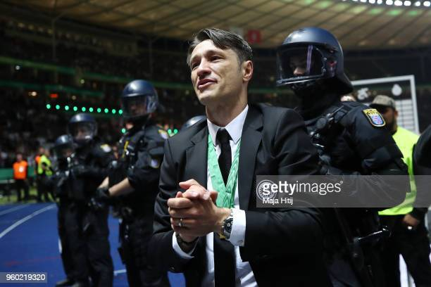 Coach Niko Kovac of Frankfurt applauds the supporters under police protection during the DFB Cup final between Bayern Muenchen and Eintracht...