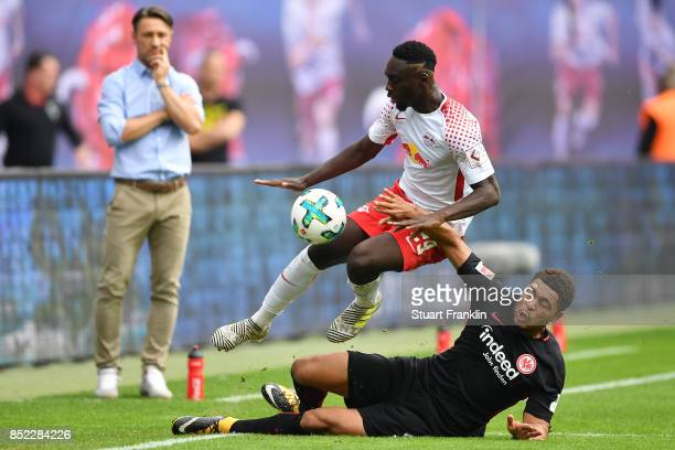 Coach Niko Kovac of Frankfurt looks on as JeanKevin Augustin of Leipzig and Simon Falette of Frankfurt fight for the ball during the Bundesliga match...