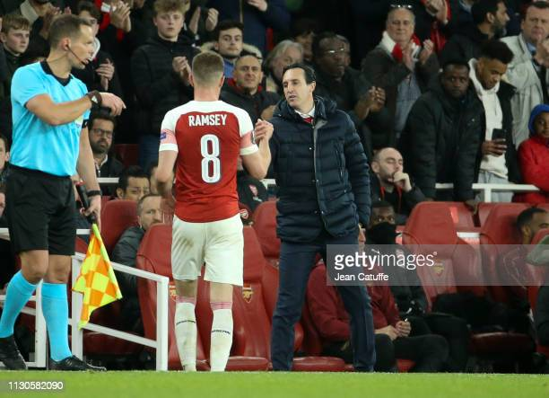 Coach of Arsenal Unai Emery salutes Aaron Ramsey when he's replaced during the UEFA Europa League Round of 16 Second Leg match between Arsenal and...
