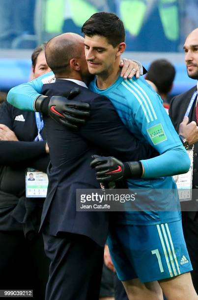 Coach of Belgium Roberto Martinez greets goalkeeper of Belgium Thibaut Courtois following the 2018 FIFA World Cup Russia 3rd Place Playoff match...