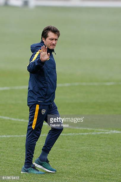 Coach of Boca Juniors Guillermo Barros Schelotto greets during a Boca Juniors training session at Complejo Pedro Pompilio on October 05 2016 in...