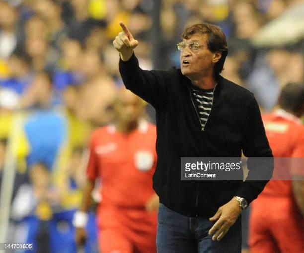 Coach of Boca Juniors Julio Cesar Falcioni gives instructions during a match as part of the Santander Libertadores Cup at Alberto J Armando Stadium...