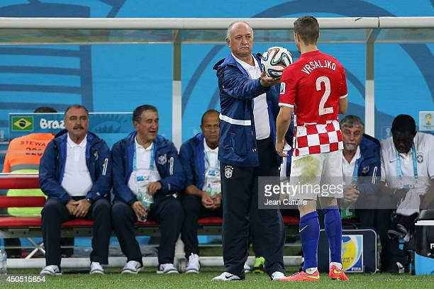 Coach of Brazil Luiz Felipe Scolari gives the ball to Sime Vrsaljko of Croatia during the 2014 FIFA World Cup Brazil Group A match between Brazil and...