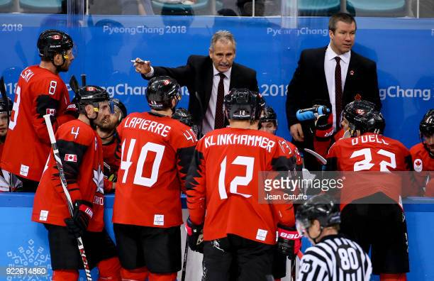 Coach of Canada Willie Desjardins talks with his players Wojtek Wolski Chris Lee Maxim Lapierre Rob Klinkhammer and Eric O'Dell during the Men's Ice...