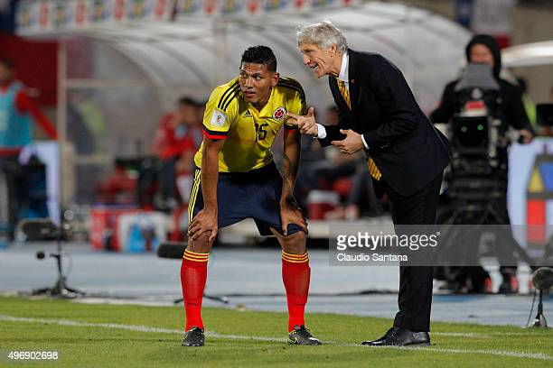 Coach of Colombia Jose Pekerman gives instructions to Alexander Mejía during a match between Chile and Colombia as part of FIFA 2018 World Cup...