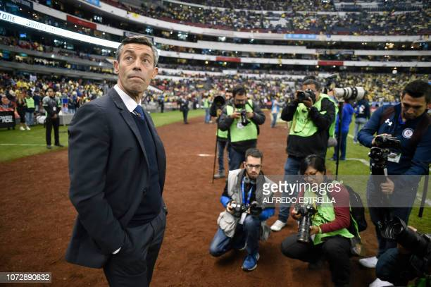 Coach of Cruz Azul Miguel Faria looks on during the National Anthem during the first round of final of the Mexican Apertura tournament football match...