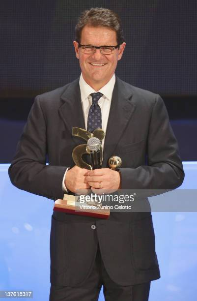 Coach of England Fabio Capello poses with the AIC Award during the Gran Gala del calcio Aic 2011 awards ceremony at Teatro dal Verme on January 23...