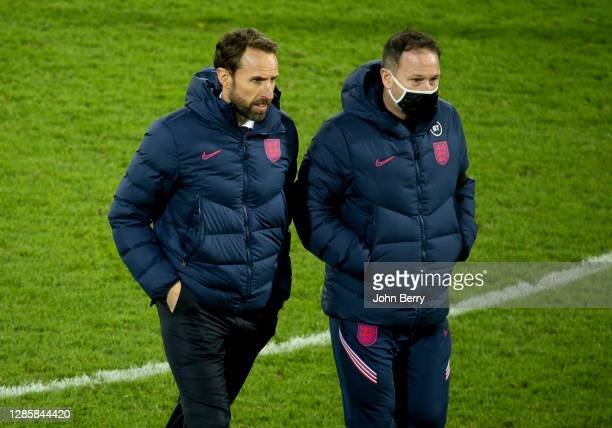 Coach of England Gareth Southgate and assistant coach Steve Holland following the UEFA Nations League group stage match between Belgium and England...