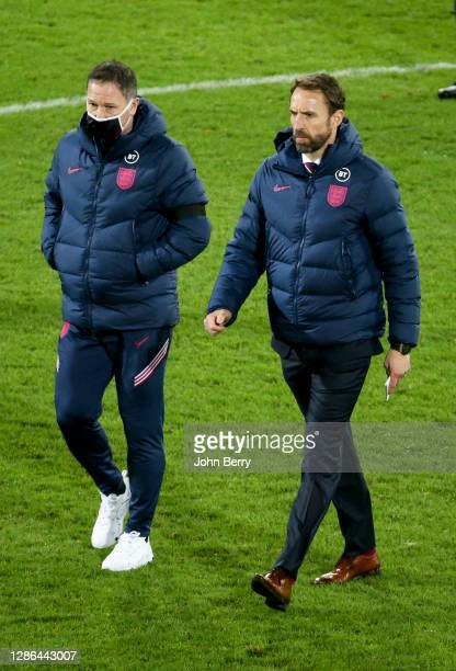 Coach of England Gareth Southgate and assistant coach Steve Holland during the UEFA Nations League group stage match between Belgium and England at...