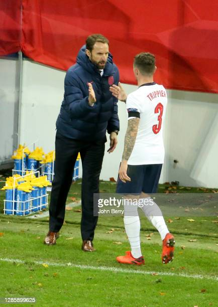 Coach of England Gareth Southgate salutes Kieran Trippier of England when he's replaced during the UEFA Nations League group stage match between...