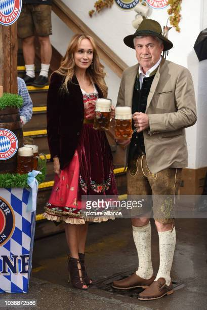 Coach of FC Bayern Munich Carlo Ancelotti and his wife Mariann Barrena McClay can be seen in front of the Kaefer tent at the arrival for the FC...