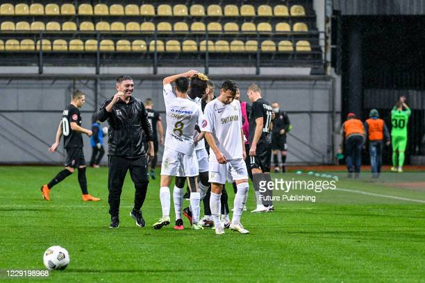 Coach of FC Kolos Kovalivka Ruslan Kostyshyn and his charges are seen after forward Yevhen Seleznov secured an added time equaliser thorough a...