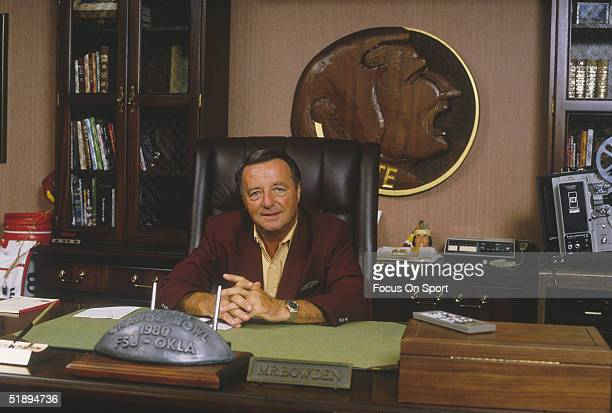 Coach of Florida State Seminoles Bobby Bowden sits behind his desk circa 1980's in Tallahassee Florida