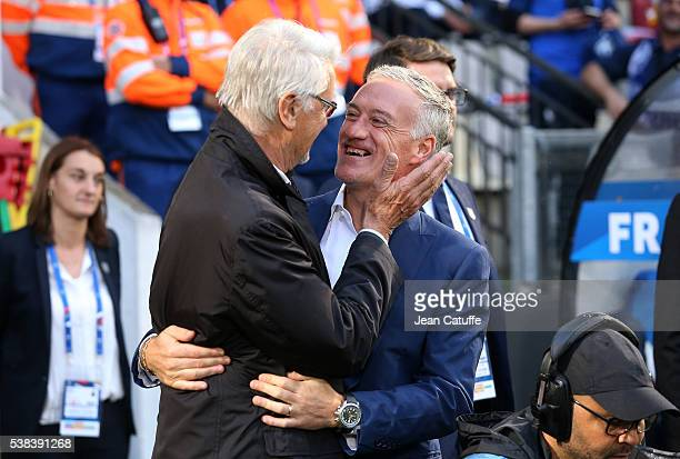 Coach of France 1998 Aime Jacquet greets his former captain coach of France Didier Deschamps before the international friendly match between France...